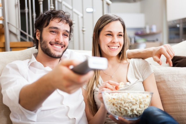 Young couple preparing to watch a movie